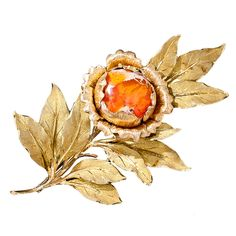 Buccellati Mexican Opal Leaf Brooch This fabulous and sizable floral brooch was created to showcase a magnificent gemological a bright orange Mexican opal with strange multi-dimensional properties and wisps of matrix on the surface. The petals of the opal centered flower are rendered in 18 karat rose gold and the lifelike leaves are created in contrasting, finely textured 18 karat yellow gold. A rare and resplendent collectable jewel. Circa early-1970s