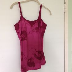 Under Armour Workout shirt Adorable under Armour work out top in a fusia like color with a great design in like new condition. Adjustable straps and built in shelf bra Under Armour Tops