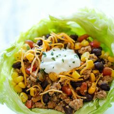 Taco Lettuce Wraps Recipe Main Dishes with olive oil, ground turkey, salsa, diced green chilies, taco seasoning, corn kernels, black beans, coriander leaf, kosher salt, ground black pepper, butter lettuce, shredded cheddar cheese, reduced-fat sour cream