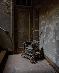 Stairs, wheelchair at bottom..   Creepy asylum photo.   The old wheelchair is pretty interesting tho.