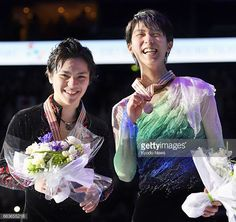 Yuzuru Hanyu and Shoma Uno of Japan smile on the...