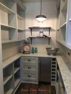 Farmhouse pantry with grey cabinets, white tile, open shelving