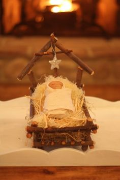 Nativity Ornament Pie Farmhouse: One of my favorite Christmas decorations is this sweet baby Jesus lying in a humble twig manger. I've had it since my kids were babies. His little face is made from a nylon stocking with painted eyes, nose and mouth. Nativity Ornaments, Nativity Crafts, Christmas Nativity, Noel Christmas, Homemade Christmas, Christmas Projects, All Things Christmas, Holiday Crafts, Christmas Ornaments