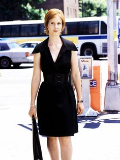 Miranda Hobbes (Cynthia Nixon) wearing a black belted dress with sharp collar in Sex and the City