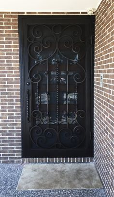 A unique wrought iron security entry door by Adoore Iron Designs located in Melbourne Australia. Wrought Iron Security Doors, Steel Security Doors, Wrought Iron Doors, Window Glass Design, Door Gate Design, Kitchen Ceiling Lights, Sliding Glass Door, Exterior Doors, Melbourne Australia