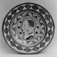 Dish Date: ca. 1480–1500 Culture: Italian (Faenza) Medium: Maiolica (tin-enameled earthenware) Dimensions: Overall (confirmed): 3 1/8 x 14 1/2 in. (7.9 x 36.8 cm) Classification: Ceramics-Pottery Credit Line: Fletcher Fund, 1946 Accession Number: 46.85.32
