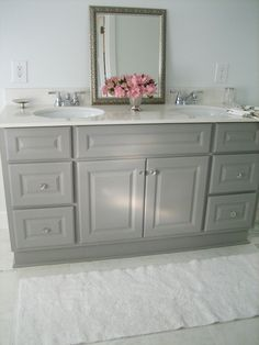 idea for girls' bathroom- dual sinks, like the grey cabinets, knobs, and could use the large mirror I already have