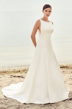 View Sleek Modern Wedding Dress - Style from Mikaella Bridal. Satin gown with bateau neckline and V-shaped Nude Tulle inserts at side seam on bodice. Spring 2017 Wedding Dresses, Bridal Wedding Dresses, Wedding Dress Styles, Bateau Wedding Dress, Lace Wedding, 2017 Bridal, Bridal Style, Sleek Wedding Dress, Simple Wedding Gowns