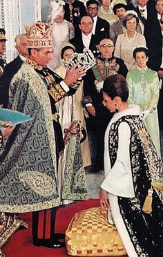 Shah crowning Empress Farah at their coronation ceremony in 1967.