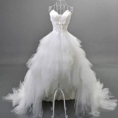 Unique Style Hi-low Sweetheart White Tulle Spaghetti Wedding Dresses With Feather, WD0067 The wedding dresses are fully lined, 4 bones in the bodice, chest pad in the bust, lace up back or zipper back