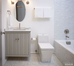 Contemporary bathroom with a gray floating vanity paired with a marble counter, undermount sink and Kohler Toobi Faucet. Blue Bathroom Interior, Blue Bathroom Vanity, Small Bathroom, Dream Bathrooms, Kohler Bathroom, Eclectic Bathroom, Gray Vanity, Guest Bathrooms, Bathroom Fixtures