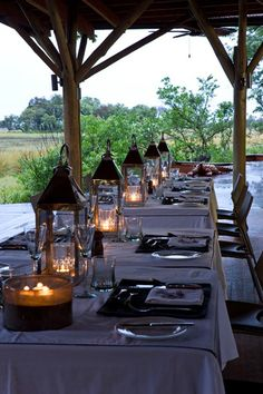 Use shorter tables like this, lining them up as if long farm tables? Outdoor Dining, Outdoor Spaces, Patio, Backyard, Bougie Partylite, Place Settings, Table Settings, Outdoor Lighting, Lantern Lighting