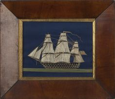 SMALL SILK NEEDLEWORK PICTURE OF A BRITISH SHIP OF THE LINE.  In period mahogany frame, 10 ½ x 12 ¼ inches.