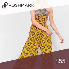 Free People Maribelle Jumpsuit yellow Yellow FP jumpsuit with cutout in middle. Only worn once. Free People Dresses Maxi