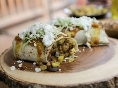 Roasted Cauliflower Burrito recipe from Guy Fieri via Food Network. Guy added cayenne, turmeric, and garam masala to the spice mix for the cauliflower, mixing the spices in the oil before mixing into the vegetables.