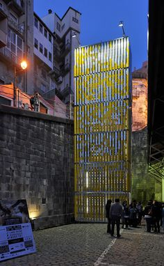 Tower of rotatable tin cans forms an interactive billboard outside a Portuguese station.