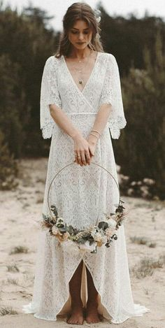 Vintage bohemian style wedding dress. Made in wonderful lace fabric. V neckline. Front opening. 3/4 sleeves. Empire waist. Cover. Bohemian Style Wedding Dresses, Wedding Dresses Plus Size, Vintage Boho Wedding Dress, Vintage Lace Weddings, Boho Vintage, Dress Vintage, White Boho Dress, White Lace Gown, White A Line Dress