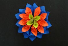 Paper Flower tutorial on how to make a Beautiful Multi-layered Kusudama Flower. Paper Flowers or Origami flowers are easy and fun to make and are very beauti...