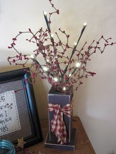 Add primitive touches to your home with our Burgundy Wood Box with Berries and Lights! https://www.primitivestarquiltshop.com/search?type=product&q=burgundy+wood+box+with+berries+and+lights #primitivecountryhomedecor