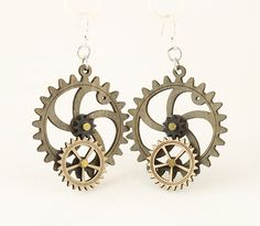 """Made in U.S.A Style # 5001G Size 1.65"""" x 1.5"""" Kinetic Gear Earring 5001G All Gears Move! Comes as shown - Gray/Natural Wood/Black Satin Made from sustainably sourced materials Laser-cut wood Stained with water based dye Ear wires are silver-finished 3041 stainless steel with new electrophoretic-coating that resists tarnishing"""