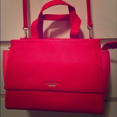 Kate Spade Adela Bag This is a gorgeous Kate Spade bag in very unique color combo- red and pink.  Worn only once, in perfect condition.  Comes with a long strap for crossbody, zippered top, convenient front and back magnetized pockets for stowing things for easy access.  Inside compartment has one zippered and 2 additional pockets. kate spade Bags Satchels