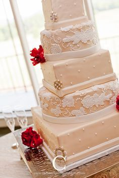 Mocha and cream lace wedding cake with a touch of claret red
