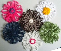 how to make yarn flowers- also links to tons of crochet projects via tangled happy!