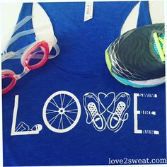 Swim, Bike, Run...show off your love of triathlon with this cute tank!  PLEASE MAKE SURE TO DOUBLE CHECK YOUR SIZE... Womens sizing: Small 2-4 Med. 6-8 Large 8-10 X-Large 10-14  This Bella & Canvas triblend tank is soft and breathable, and the racerback style gives it a sporty feel. • Fabric laundered • Made of 50% polyester, 25% combed ringspun cotton, 25% rayon • Satin label • Racerback • Image designed and created by artist and athlete  COLOR: True Royal Triblend