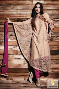 Tan color Pakistani kaftan dress. This fashionable salwar suit made by chiffon and net fabric with embroidery work which looks glamorous and hot. #salwarsuit, #embroiderydress more: http://www.pavitraa.in/store/embroidery-salwar-suit/