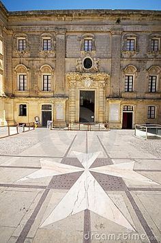 Maltese cross in the courtyard at the Vilhena Palace in Mdina, Malta