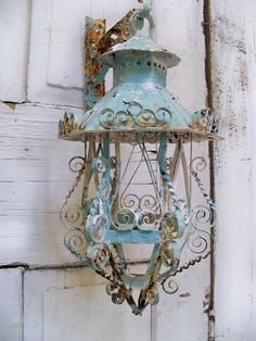 Vintage scroll work metal lantern candle by AnitaSperoDesign. $50.00, via Etsy.