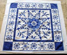 Beautiful blue and white quilt by Carla Barrett -- think I might need to make another feathered star!