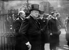 Winston Churchill leaving Westminster Abbey after the memorial service for former Prime Minister David Lloyd George. Clement Attlee can be seen in the background.