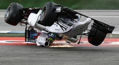 Williams Formula One driver Felipe Massa of Brazil crashes with his car in the first corner after the start of the German F1 Grand Prix at the Hockenheim racing circuit, Germany, July 20, 2014. REUTERS-Kai Pfaffenbach