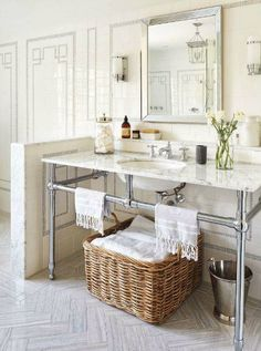 thefoodogatemyhomework:  Actually obsessed with the grey key detailing in the tile walls of this tonal and beautiful bathroom by Ingrid Ooma. Wood grained tile, herringbone floors are also pretty awesome.
