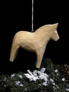 Hand-carved, unpainted Dala Horse Ornament; $12 at Posh in Chicago. Have mine in my tree every Christmas.