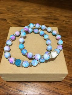 A personal favorite from my Etsy shop https://www.etsy.com/listing/527484233/mottled-glass-diffuser-bracelet-set