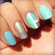 Light blue, minty green, and a holographic silver come together with a color block accent nail.