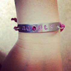 Take a look at this awesome photo of #Rescue Mom Blog wearing our #Adopt #Bracelet in #pink!