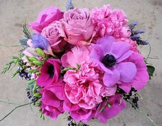 Hot pink peonies, anemones, purple freesia, purple roses, and lavender