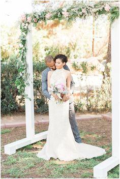 Jen Jinkens PhotosDowntown Phoenix | Urban Spring Wedding | Jen Jinkens Photography | Wedding Posing | Wedding Floral Arch