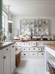 Love all the details on this simple white kitchen.