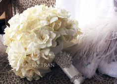 Classic white gardenia bouquet with crystal brooch