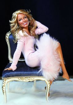 Pull up a chair and get in the pink with Farrah Fawcett (version 1.0). Farrah as painted, styled by artist Cruz for www.myfarrah.com. Farrah is wearing a Baby Girl Pink Fur Trim Dress An Original Design by Kolkman Kreations. Chair by Ken Haseltine of www.regentminiatures.com. Farrah is on facebook www.facebook.com/FLFawcett On Tumblr at; farrahlenifawcett.tumblr.com Photo/Graphic Layout & web sites www.ncruz.com & www.myfarrah.com by www.stevemckinnis.com.