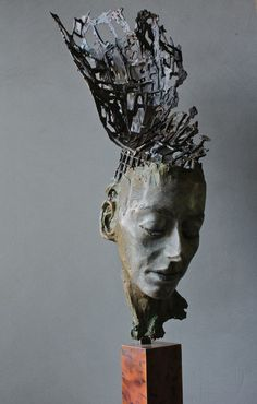 """"""" I grew up surrounded by towering ceramic forms made by my father. My early work was very much influenced by machines, until my 20's when after studying 3d design at art college i discovered a love/obsession with the human face which is still my driving force. My influences are varied but include contemporary dance,the writings of Carl Jung and Ian McGilchrist & Siddhartha Gautama. I believe that art is more important than ever as a way of utilising the whole of our brains, Especially in…"""