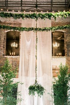 Gauzy Drapery and a Greenery Chandelier for an Enchanting Industrial Wedding Ceremony at Aria