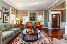 Living room with neutral paint and Brazilian Cherry hardwood floors. Living Room Hardwood Floors, Living Room Wood Floor, My Living Room, Living Room Decor, Bungalow Living Rooms, Craftsman Living Rooms, Casual Living Rooms, Craftsman Home Decor, Craftsman Interior