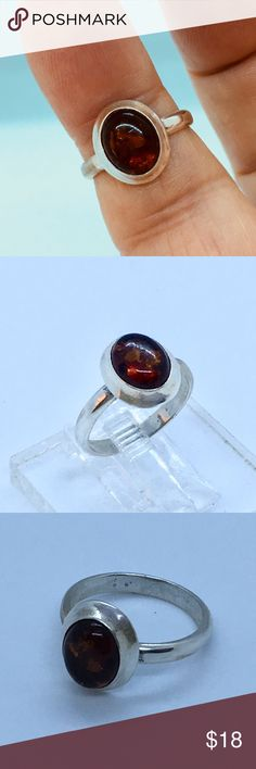 Sterling Silver Amber Ring This is a  Amber sterling earring which I have repurposed into a ring. The ring is sterling Size 7 1/2. Free resizing available when ordered. Just convo me. designsbysteve Jewelry Rings