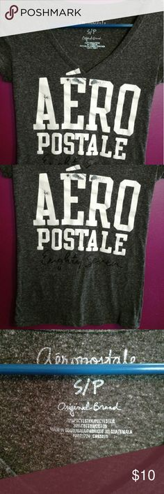 Gray Aeropostale v neck top I'm moving and all must go by the end of August send me an offer all will be donated before I move. Distressed design good condition small tee. Aeropostale Tops Tees - Short Sleeve