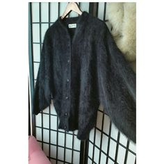 Angora vintage sweater soft excellent condition Black angora cardigan vintage sweater is super soft in excellent condition no signs of wear each button is a rhinestone button the top is a little bit bigger like an eighties style sweater so it could fit medium or large the sleeves are tapered and everything is in mint condition we are a smoke-free closet no visible signs of wear Vintage  Sweaters Cardigans